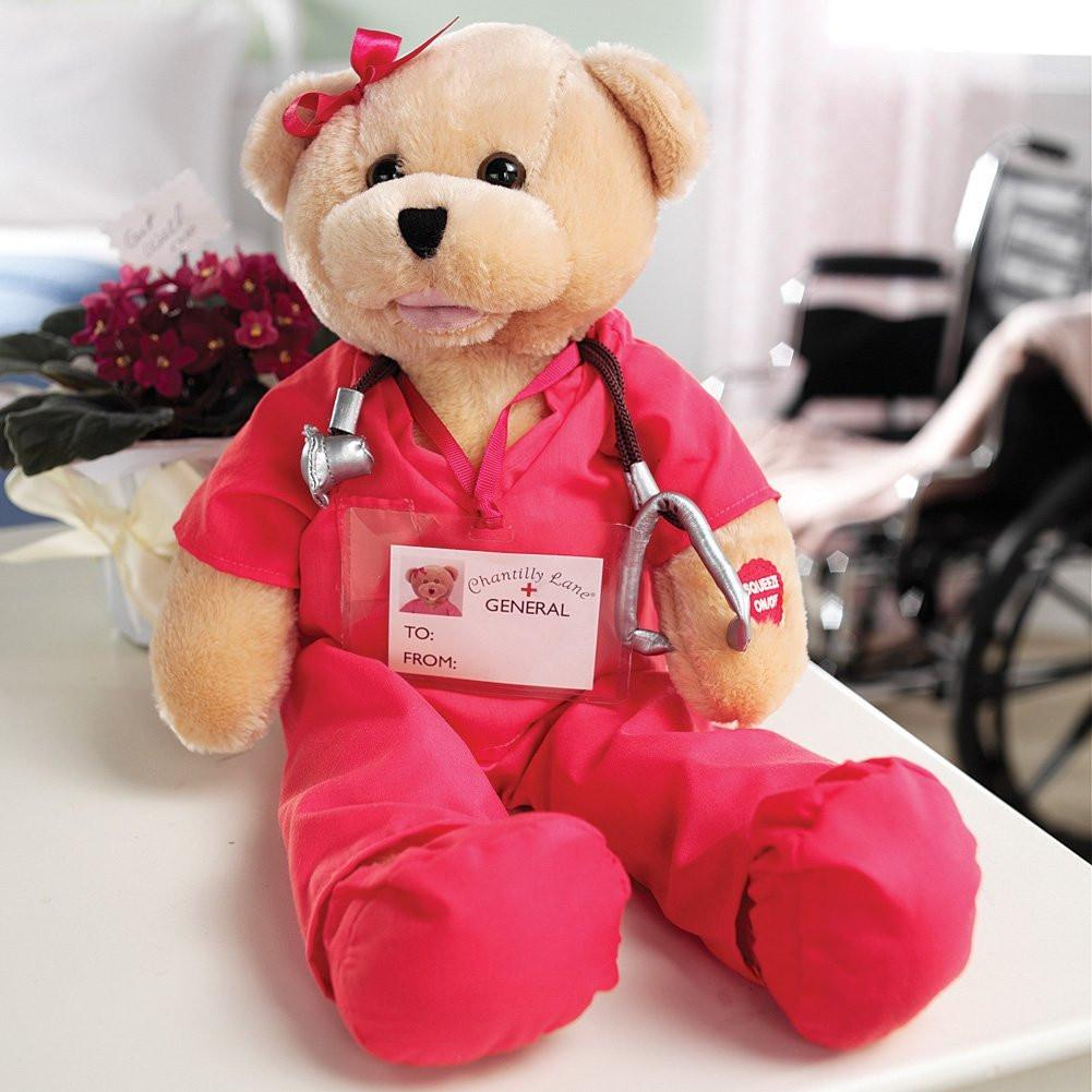 Beautiful Pink Scrubs Bear. Head sways & mouth moves while singing,