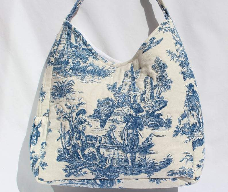 Dark Blue Toile hobo bag with plenty of pockets, braided handle        Update your settings