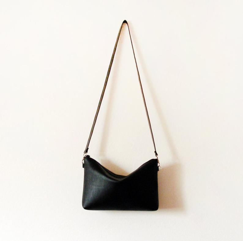 Black leather crossbody bag with zipper        Update your settings